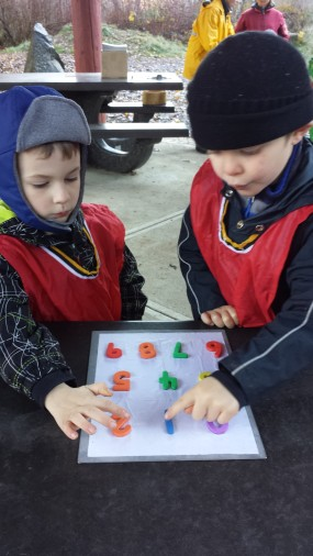 Nolan and Trevor counting the completed puzzle, slowly and together.