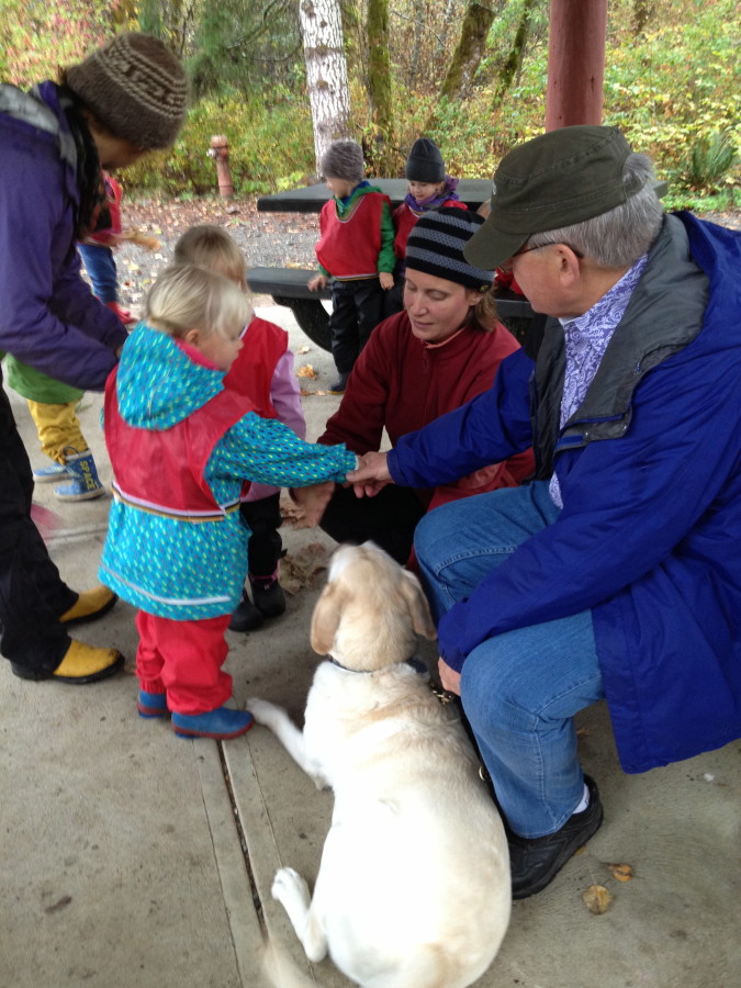 Saying thank you to Paul for visiting us - the children's hands were guided into Paul's for shaking