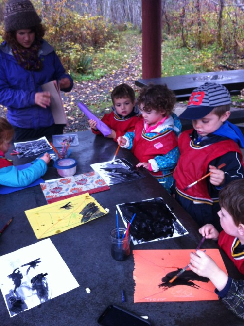 Making spider webs and other designs using dark dark black paint.