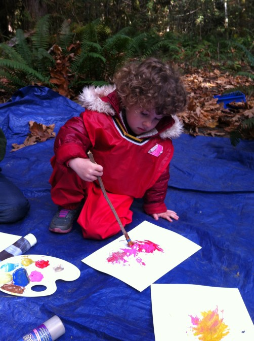 Wearing red and painting red with our own natural material paintbrushes.