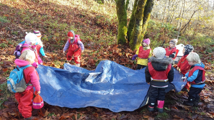 There are moments when everyone works together, such as this one, when figuring out which way the tarp goes for snack can be a group effort!