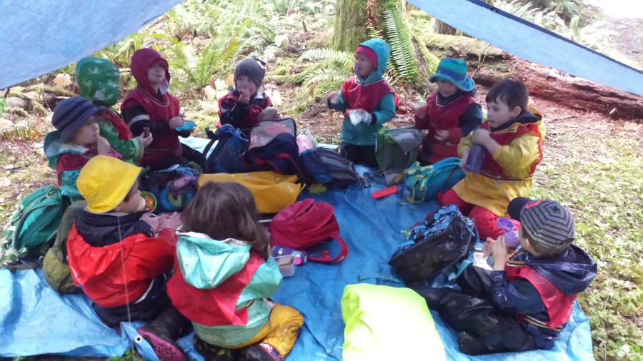 Snacking and creating community under a dry shelter.