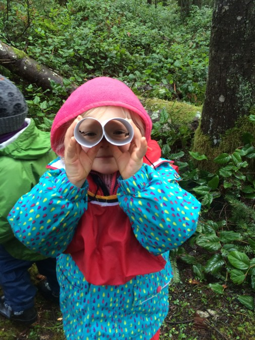 Poppy is peering through her 'bird goggles' which they were aptly named, rather than binoculars