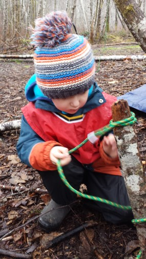 James has shown interest in tying and untying rope lately. Here he is helping to tie down the tarp on a particularly rainy day!