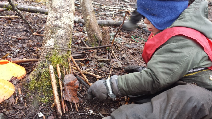 Nolan is reconstructing a fairy house after accidentally stepping on his friends. They showed him how to re-make it and he happily responded positively to make up for his accident, and in doing this he learned how to find the right size sticks and lean them up to create a cute mini-shelter!