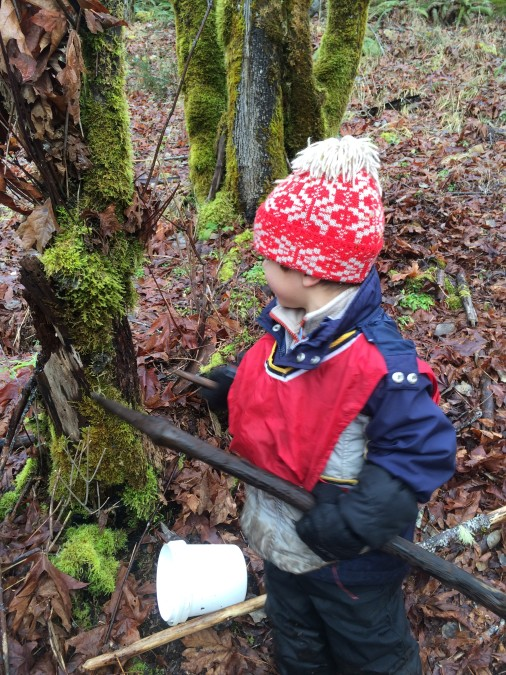 Dawson re-enacted the maple tapping with a stick. He drilled into the positively identified maple tree, added an imaginary spile, and found a bucket to collect the sap.