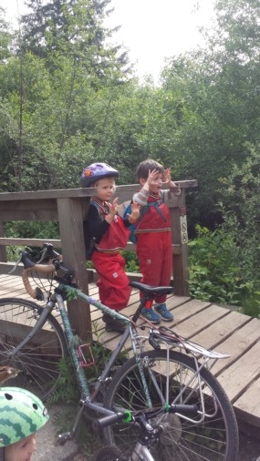 Torin and Poppy have different hand signals to their friends to 'STOP' at the bridge for a salmon berry snack!